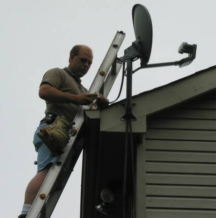 Bill from B&M installs the 18x24 triple LBN DirecTV satellite dish